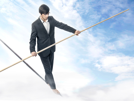 http://www.dreamstime.com/royalty-free-stock-images-walking-tightrope-image9606849